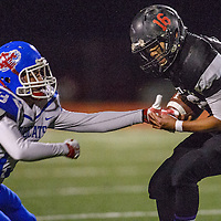 Crownpoint Eagle Noah Manuelito (16) shakes off McCurdy Bobcat Josh Waters (13) Friday at Crownpoint High School.