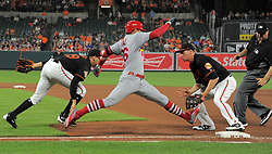 June 16, 2017 - Baltimore, MD, USA - Baltimore Orioles relief pitcher Gabriel Ynoa, left, tries to underhand the ball to first baseman Trey Mancini on a dribbler hit by the St. Louis Cardinals' Aledmys Diaz, which rolled back into fair territory at Oriole Park at Camden Yards in Baltimore on Friday, June 16, 2017. The Cardinals won, 11-2. (Credit Image: © Karl Merton Ferron/TNS via ZUMA Wire)