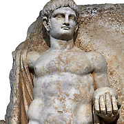 Detail of a Roman Sebasteion relief  sculpture of Emperor Nero with captive, Aphrodisias Museum, Aphrodisias, Turkey.   Against a white background.<br /> <br /> Naked warrior emperor Nero holds the orb of world rule in one hand and crowns the military trophy with the other. Between the trophy and the emperor stands a bound captive boy. He wears long barbarian trousers and looks up at Nero.