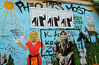 Berlin's amazing street art often contains well designed social commentary and is added to by others creating a living changing wall.