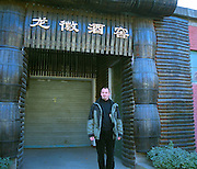 Jérôme Sabaté, Vice-Director General and Winemaker at Beijing Dragon Seal Wines Co Ltd - outside the entrance to the wine cellar, decorated with barrel staves and barrel parts Beijing, China, Asia
