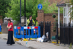 """© Licensed to London News Pictures. 02/06/2021. Aylesbury, UK. Evidence bags next to an area of interest following a fatal incident, believed to involve an electrical worker, in Fairford Leys Way, Aylesbury. South Central Ambulance Service (SCAS) were called at 11:30am and sent a rapid response vehicle, ambulance crew, ambulance o fficer and the Thames Valley Air Ambulance to assist one patient. A Thames Valley Police spokesperson said: """"This was the sudden death of a man in Fairford Leys Road, Aylesbury, which was reported at around 11.40am today (2/6). Officers attended along with paramedics. Next of kin have been made aware and are being supported. The death is not being treated as suspicious."""" Photo credit: Peter Manning/LNP"""