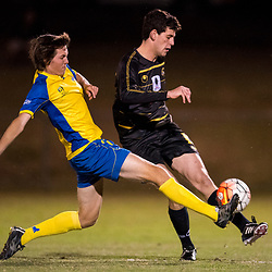 BRISBANE, AUSTRALIA - AUGUST 26: Corey Lucas of Moreton Bay is tackled by Jeremy Stewart of the Strikers during the NPL Queensland Senior Men's Semi Final match between Brisbane Strikers and Moreton Bay Jets at Perry Park on August 26, 2017 in Brisbane, Australia. (Photo by Patrick Kearney)