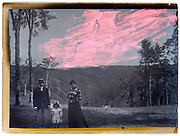 1900s family group portrait glass plate with cloud retouching marks
