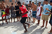 Serious dance moves. Young men guys on a rooftop dancing passinho to funk Carioca, Baile funk, Vila Valquiere, West Zone Zona Oueste, Rio de Janeiro