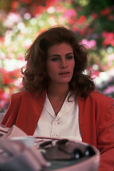 RELEASE DATE: March 23, 1990 <br /> MOVIE TITLE: Pretty Woman <br /> STUDIO: Touchstone Pictures <br /> DIRECTOR: Garry Marshall <br /> PLOT: A man in a legal but hurtful business needs an escort for some social events, and hires a beautiful prostitute he meets... only to fall in love. <br /> PICTURED: JULIA ROBERTS as Vivian Ward.  <br /> (Credit Image: © Touchstone Pictures/Entertainment Pictures/ZUMAPRESS.com)
