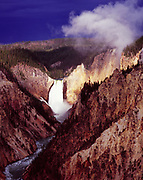 Dramatic light with approaching thunderstorm illuminating Lower Falls of the Yellowstone River, Artist Point, Grand Canyon of the Yellowstone, Yellowstone National Park, Wyoming.