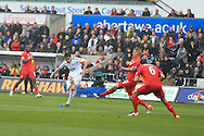 Jack Cork of Swansea city shoots and scores his teams 2nd goal.  Barclays Premier league match, Swansea city v Liverpool  at the Liberty Stadium in Swansea, South Wales on Sunday 1st May 2016.<br /> pic by  Andrew Orchard, Andrew Orchard sports photography.