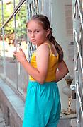 Girl age 10 in yellow and blue pastels.  Zakopane Poland