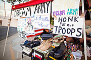 """Sept. 19 - PHOENIX, AZ: A tent put up by protesters supporting the DREAM Act in Phoenix Sunday. About 30 people met in front of US Sen. John McCain's office in Phoenix Sunday night to demonstrate in support of the DREAM Act, which is scheduled to be debated in the US Senate on Tuesday, Sept 21. The Development, Relief and Education for Alien Minors Act (The """"DREAM Act"""") is a piece of proposed federal legislation in the United States that was introduced in the United States Senate, and the United States House of Representatives on March 26, 2009. This bill would provide certain illegal immigrant students who graduate from US high schools, who are of good moral character, arrived in the U.S. as minors, and have been in the country continuously for at least five years prior to the bill's enactment, the opportunity to earn conditional permanent residency. In the early part of this decade McCain supported legislation similar to the DREAM Act, but his position on immigration has hardened in the last two years and he no longer supports it. The protesters, mostly area students, marched and drilled to show their support for the US military and then held a candle light vigil.   Photo by Jack Kurtz"""