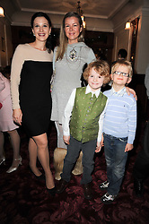 Left to right, OLGA BALAKLEETS, STEPHANIE GORBOUNOVA, Olga's son JOHN and Stepahnie's son MARCEL at a Russian Christmas and New Year Performance of Cinderella at the Shaftesbury Theatre, London on 5th December 2010.