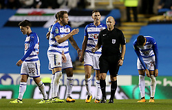 Referee Andy Davies is surrounded by Reading players after the second goal during the Carabao Cup, third round match at the Madejski Stadium, Reading.
