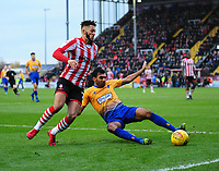Lincoln City's Kellan Gordon vies for possession with  Mansfield Town's Malvind Benning<br /> <br /> Photographer Andrew Vaughan/CameraSport<br /> <br /> The EFL Sky Bet League Two - Lincoln City v Mansfield Town - Saturday 24th November 2018 - Sincil Bank - Lincoln<br /> <br /> World Copyright © 2018 CameraSport. All rights reserved. 43 Linden Ave. Countesthorpe. Leicester. England. LE8 5PG - Tel: +44 (0) 116 277 4147 - admin@camerasport.com - www.camerasport.com