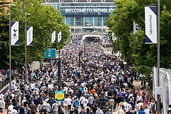 London, August 20 2017. Crowds stream towards the stadium from Wembley Park Tube station as Tottenham Hotspur host their first game of the Premier League season at their temporary home ground, Wembley Stadium, hosting Chelsea FC. © Paul Davey.