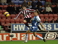 Photo: Paul Greenwood.<br />Wigan Athletic v Sheffield United. The Barclays Premiership. 16/12/2006. Sheffield's Keith Gillespie shoots past Wigan's Arjan de Zeeuw