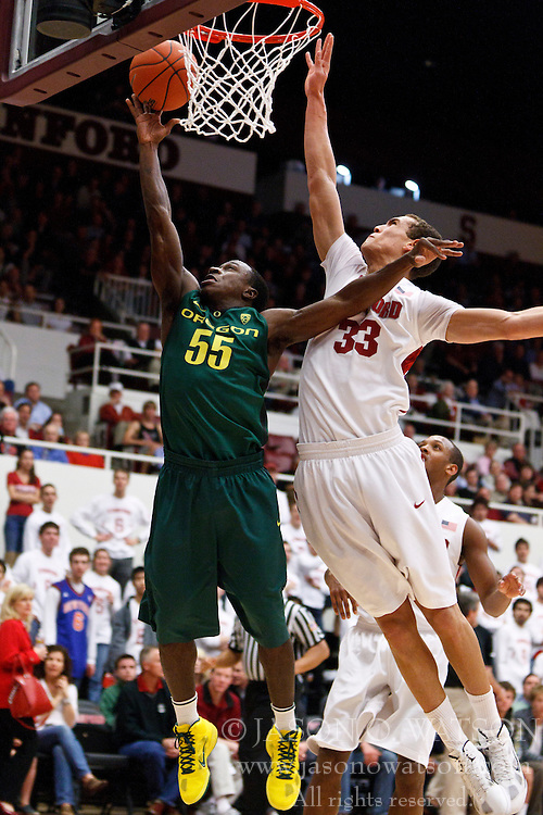 January 27, 2011; Stanford, CA, USA;  Oregon Ducks guard Jay-R Strowbridge (55) is defended on a shot by Stanford Cardinal forward Dwight Powell (33) during the first half at Maples Pavilion.