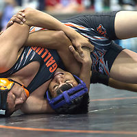 Gallup Bengal Young Plummer pins Miyamura Patriot Tyrell Cher at the Gallup meet hosted at Chief Manuelito Middle School Saturday.
