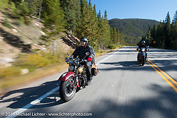After his HD VL suffered a catastrophic failure, Jason Sims rides a 1939 Harley-Davidson Knucklehead from Carl's Cycles during Stage 10 (278 miles) of the Motorcycle Cannonball Cross-Country Endurance Run, which on this day ran from Golden to Grand Junction, CO., USA. Monday, September 15, 2014.  Photography ©2014 Michael Lichter.