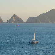 Cabo San Lucas Bay at sunset with sailboats and The Arch in the background. BCS.