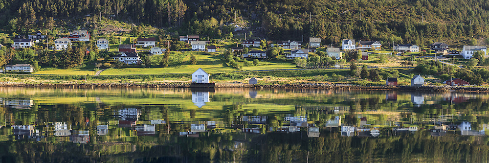 Panoramic view at Remøy, nearby Fosnavåg, Norway. Early morning light with reflections in the sea   Nydelig morgenlys på Remøy, med spegling i sjøen