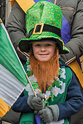 Mark, aged 5, is a supporter of the St Coleman's Pipe Band from Ballindaggin -  the London St Patrick's Day parade from Piccadilly to Trafalgar Square.