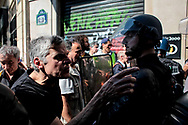 An angry man screaming to the police.