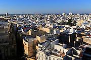 Rooftops buildings in Barrio de la Vina, looking west city of Cadiz, Spain