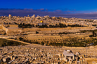 Gravestones, Jewish Cemetery on the Mount of Olives, with the Dome of the Rock on the Temple Mount in background, Jerusalem, Israel.
