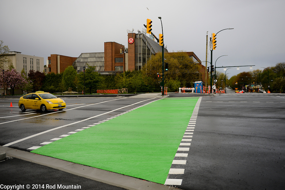 A newly painted crosswalk is distinguished with green paint. Burrard Street, Vancouver, BC.<br /> <br /> Photo: © Rod Mountain