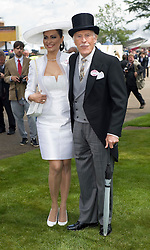 © licensed to London News Pictures.16/06/2011. Ascot, UK. Bruce Forsyth and His wife WIlnelia at Ladies day at Royal Ascot races today (16/06/2011). The 5 day showcase event is one of the highlights of the racing calendar. Horse racing has been held at the famous Berkshire course since 1711 and tradition is a hallmark of the meeting. Top hats and tails remain compulsory in parts of the course. Photo credit should read: Ben Cawthra/LNP