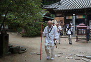 Pilgrims, known as a Henro, at shite temple on the Shikoku 88 Temple pilgrimage, Matsuyama, Eihime, Japan.. Friday, June 26th 2015