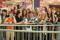 """Fans wait to see Leigh Francis in character as TV JUICE host Keith Lemon poses for photos with fans while signing copies of his new book. 'Keith Lemon: The Rules""""  when he stopped in at WHSmith Meadowhall shopping centre in Sheffield. The event scheduled for 5:00 - 5:30 was so popular that Keith started signing early and didn't finish until 7:05pm as well as sales of the book being restricted.  .1st November 2011. Image © Paul David Drabble"""