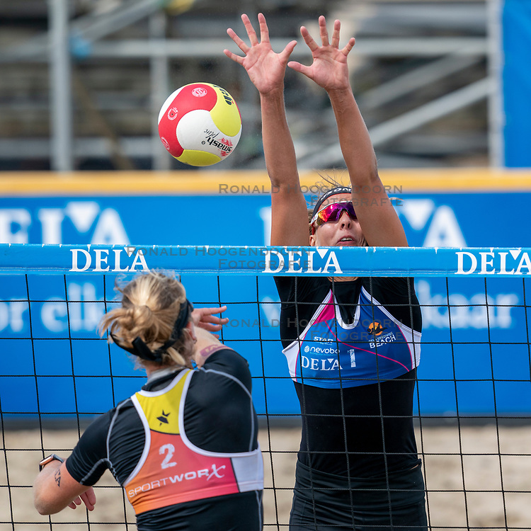 Katja Stam in action in the Final of the DELA NK Beach volleyball for men and women will be played in The Hague Beach Stadium on the beach of Scheveningen on 23 July 2020 in Zaandam.