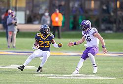 Nov 14, 2020; Morgantown, West Virginia, USA; West Virginia Mountaineers safety Tykee Smith (23) intercepts a pass from TCU Horned Frogs quarterback Max Duggan (15) and runs for extra yards during the fourth quarter at Mountaineer Field at Milan Puskar Stadium. Mandatory Credit: Ben Queen-USA TODAY Sports