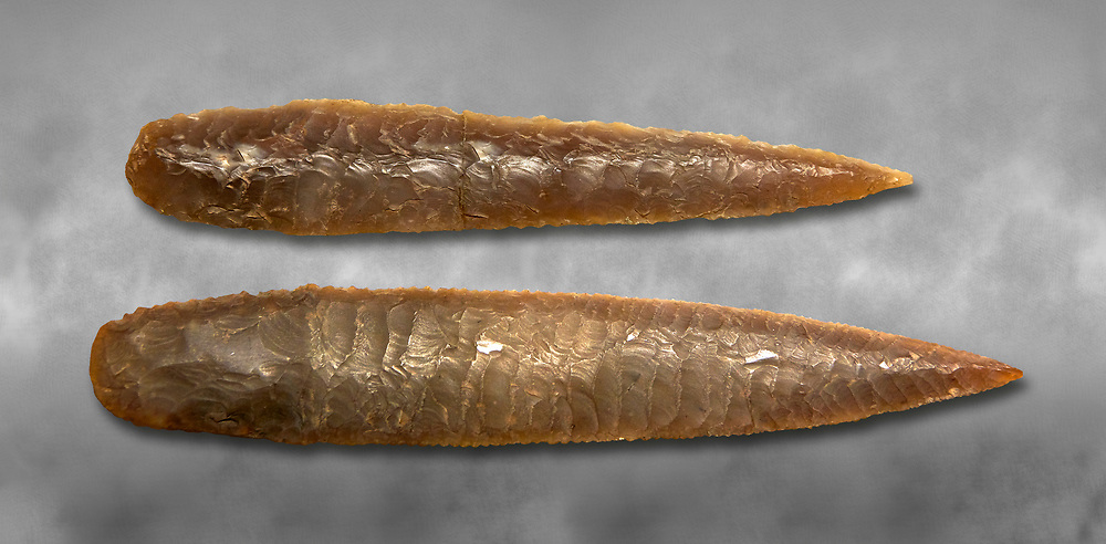 Brown obsidian dagger blades. Catalhoyuk Collections. Museum of Anatolian Civilisations, Ankara. Against a gray mottled background .<br /> <br /> If you prefer you can also buy from our ALAMY PHOTO LIBRARY  Collection visit : https://www.alamy.com/portfolio/paul-williams-funkystock/prehistoric-neolithic-art.html - Type Catalhoyuk into the LOWER SEARCH WITHIN GALLERY box. Refine search by adding background colour, place, museum etc.<br /> <br /> Visit our PREHISTORIC PLACES PHOTO COLLECTIONS for more  photos to download or buy as prints https://funkystock.photoshelter.com/gallery-collection/Prehistoric-Neolithic-Sites-Art-Artefacts-Pictures-Photos/C0000tfxw63zrUT4
