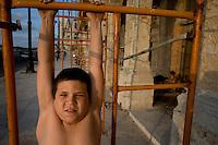 portrait of chubby cuban boy of scaffolding