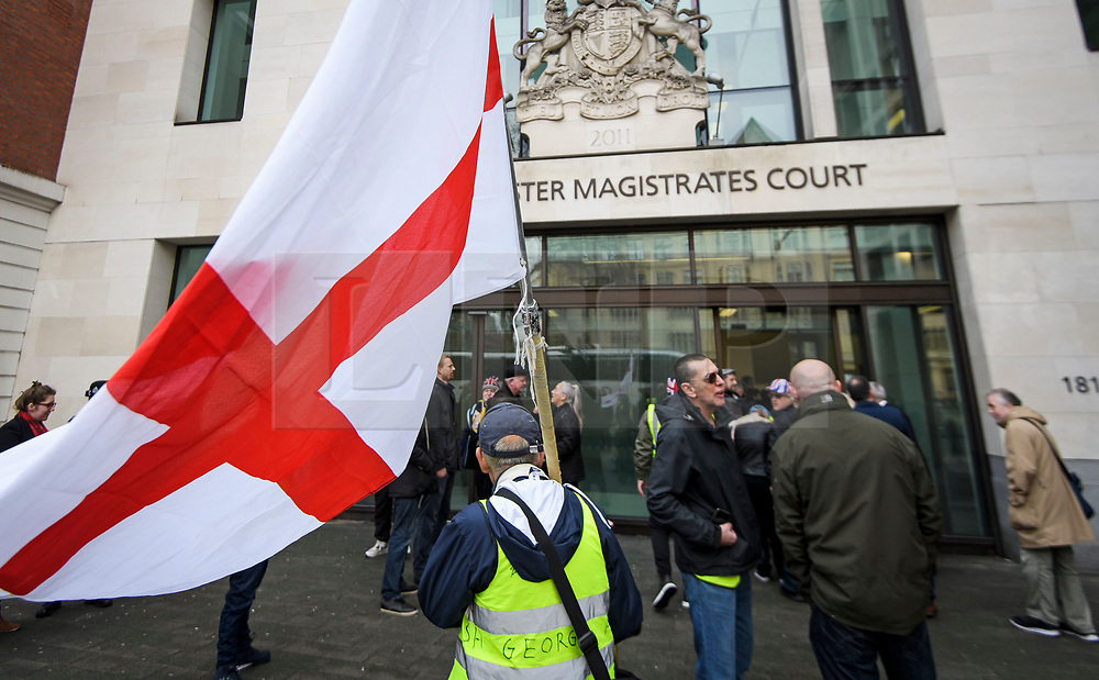 © Licensed to London News Pictures. 19/03/2019. London, UK. A Yellow Vest protestor waves the England flag, the Cross of Saint George, outside Westminster Magistrates Court in London where James Goddard is charged with harassing MP Anna Soubry and two public order offences against a police officer.  Photo credit: Ben Cawthra/LNP