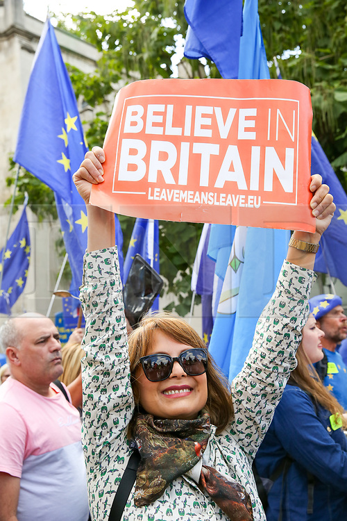 "© Licensed to London News Pictures. 03/009/2019. London, UK. A rival Pro-EU protester jumps as hundreds of anti-Brexit protesters take part in ""Stop The Coup"" demonstration in Westminster. MPs return to Westminster for a no deal  showdown that could result in a snap election. Photo credit: Dinendra Haria/LNP"