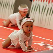 Amsterdam, 19-02-2014. Een baby tijdens de luierrace op de jaarlijkse Negenmaandenbeurs. Vijf dagen lang is er in de Rai alles te vinden op het gebied van zwangerschap en geboorte.