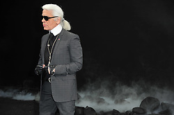 Karl Lagerfeld posing at the Chanel Ready-To-Wear Fall-Winter 2011-2012 fashion show designed by Karl Lagerfeld at the Grand Palais in Paris, France on March 8, 2011, as part of the Paris Fashion Week. Photo by Frederic Nebinger/ABACAPRESS.COM