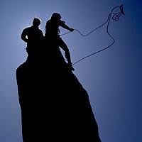ROCK CLIMBING. Doug Robinson and Jay Jensen atop Cardinal Pinnacle, Sierra Nevada, CA. (MR)