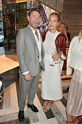 MAT COLLISHAW and POLLY MORGAN at the opening of Roksanda - the new Mayfair Store for designer Roksanda Ilincic at 9 Mount Street, London on 10th June 2014.