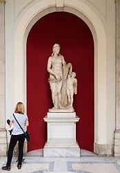 Statue Venus Felix Roman version of Venus with Cupid in Octagonal Courtyard of Belvedere ,Vatican Museum,  Rome, Italy