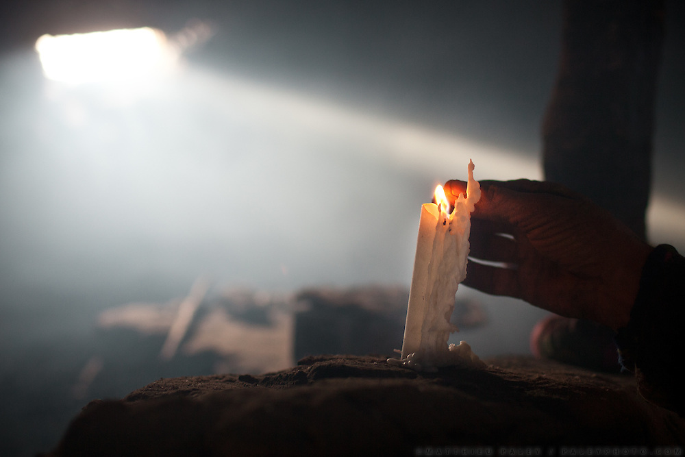 A candle is lit at Kossim's house. Wakhi people, before turning to Islam, use to be Zoroastrian and worship fire. Langar, Wakhi winter shepherd settlement..Trekking up to the Little Pamir with yak caravan over the frozen Wakhan river.