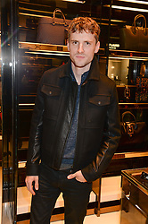 GEORGE BARNETT at a party hosted by Gucci & Clara Paget to drink a new cocktail 'I Bamboo You' held at Gucci, 34 Old Bond Street, London on 16th October 2013.