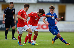 RHYL, WALES - Monday, September 4, 2017: Wales' Daniel Mooney is tackled by Iceland's Alex Þor Hauksson during an Under-19 international friendly match between Wales and Iceland at Belle Vue. (Pic by Paul Greenwood/Propaganda)