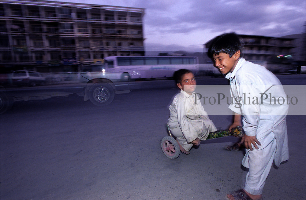 Children playing with a handcart in the  streets of Jadda district