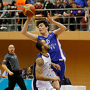 Istanbul BSB's Zack Wright (F) and Anadolu Efes's Cedi Osman (B) during their Turkish Basketball League match Istanbul BSB between Anadolu Efes at Cebeci Arena in Istanbul Turkey on Monday 09 March 2015. Photo by Aykut AKICI/TURKPIX