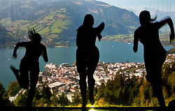 05.05.2011, Ferry Porsche CONGRESS CENTER, Zell am See, AUT, IRONMAN 70.3 Salzburg, im Bild drei weibliche Silhouetten laufen Schattenspiele während der Präsentations- Pressekonferenz des Ironman 70.3 Zell am See Kaprun, der am 26. August 2012 erstmals über die Bühne geht // three female silhouettes run, EXPA Pictures © 2011, PhotoCredit: EXPA/ J. Feichter