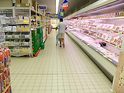 man shopping for his groceries in a big new supermarket